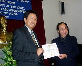 Kent Wong recieves award from Vietnamese communist labor leader Nguyen Hoa Binh, 2007