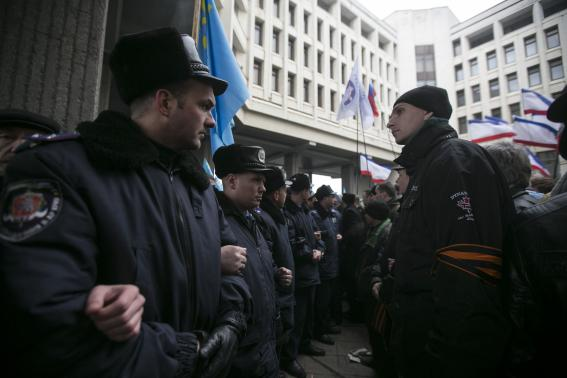Ukrainian police separate ethnic Russians and Crimean Tatars during rallies near the Crimean parliament building in Simferopol