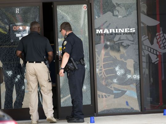 The bullet-riddled door of Marine recruiting office after Islamic radical opened fire on the building July 16 in Chattanooga, Tenn.