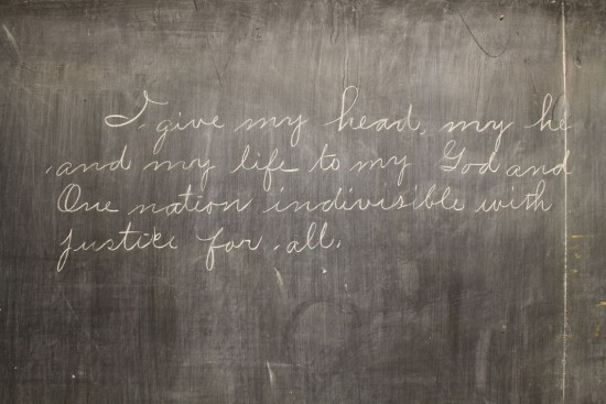 """I give my head my heart and my life to my God and one nation indivisible with justice for all."" - Uncovered classroom chalkboard from 1917"