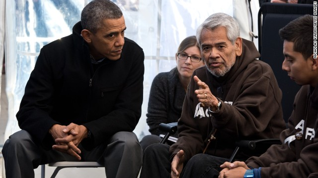 President Barack Obama listens to former SEIU executive Vice President Eliseo Medina via CNN
