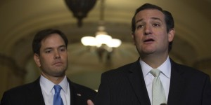 Senator Ted Cruz, a Republican from Texas, right, speaks during a news conference with Senator Marco Rubio, a Republican from Florida, following a vote in Washington, D.C., U.S., on Friday, Sept. 27, 2013. The U.S. Senate voted to finance the government through Nov. 15 after removing language to choke off funding for the health care law, putting pressure on the House to avoid a federal shutdown set to start Oct. 1. Photographer: Andrew Harrer/Bloomberg via Getty Images