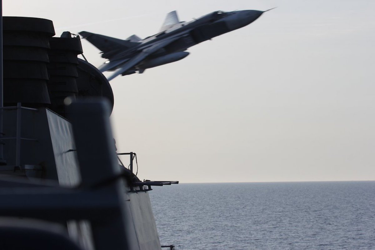 """The repeated flights by the Sukhoi SU-24 warplanes, which also flew near the ship a day earlier, were so close they created wake in the water, with 11 passes, the official said."" - Business Insider"