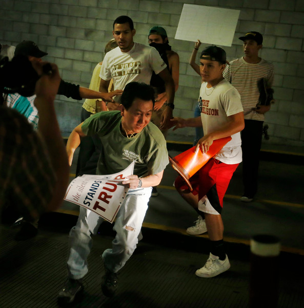 Protesters harass a Trump supporter in the San Jose Convention Center parking garage as Presidential candidate Donald Trump holds a rally in San Jose, Calif., Thursday, June 6, 2016. (Patrick Tehan/Bay Area News Group)